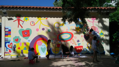 painting murals with children
